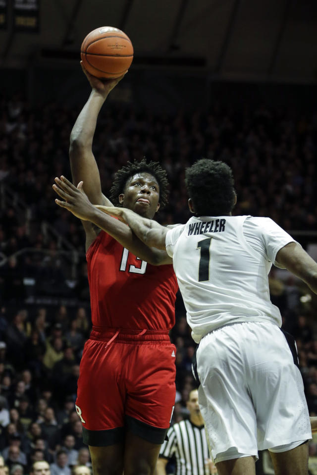 Rutgers forward Shaq Carter, left, shoots over Purdue forward Aaron Wheeler during the first half of an NCAA college basketball game in West Lafayette, Ind., Tuesday, Jan. 15, 2019. (AP Photo/AJ Mast)