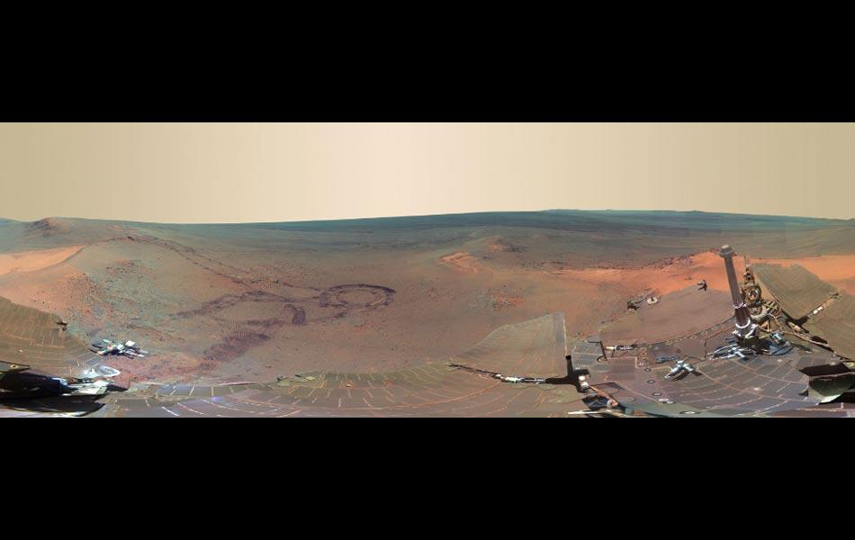 """A full-circle scene combining 817 images taken by the panoramic camera (Pancam) on NASA's Mars Exploration Rover Opportunity. The US space agency NASA is calling it the """"next best thing to being"""" on the Red Planet."""