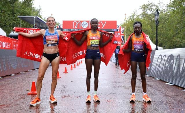 Kenya's Brigid Kosgei (centre) celebrates winning the elite women's race alongside second-placed USA's Sara Hall (left) and Kenya's Ruth Chepngetich in third