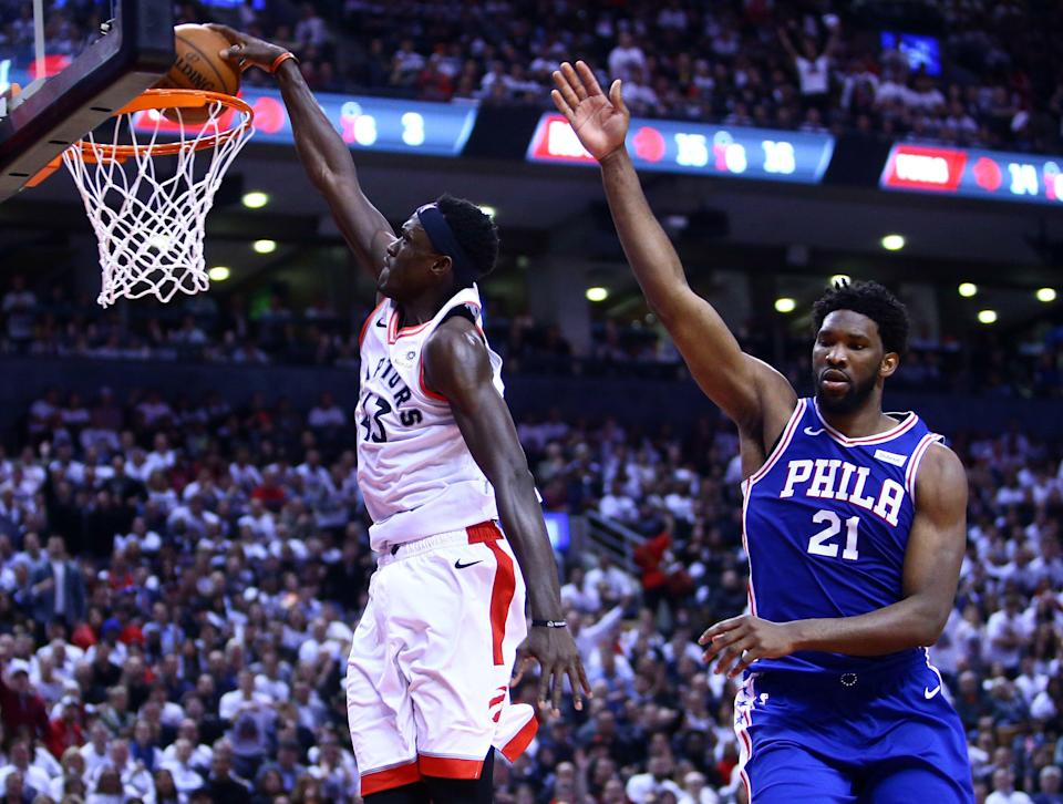 TORONTO, ON - MAY 07:  Pascal Siakam #43 of the Toronto Raptors dunks the ball as Joel Embiid #21 of the Philadelphia 76ers defends in the second half during Game Five of the second round of the 2019 NBA Playoffs at Scotiabank Arena on May 7, 2019 in Toronto, Canada.  NOTE TO USER: User expressly acknowledges and agrees that, by downloading and or using this photograph, User is consenting to the terms and conditions of the Getty Images License Agreement.  (Photo by Vaughn Ridley/Getty Images)