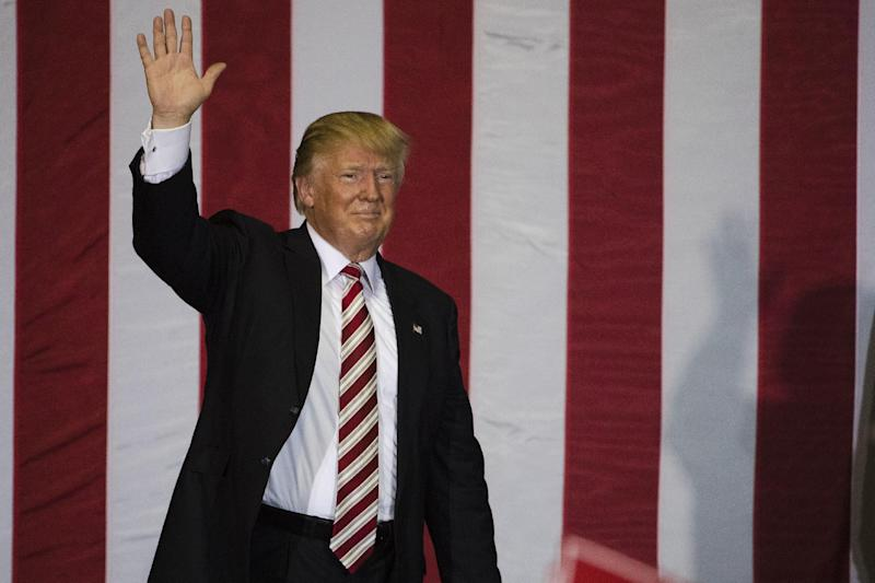 FILE - In this Nov. 3, 2016 file photo, Republican presidential candidate Donald Trump waves during a campaign stop at the Jacksonville Equestrian Center in Jacksonville, Fla. Hundreds of parents across the country have called on President Donald Trump to embrace Obama-era protections for transgender students that call for letting them use school bathrooms in accordance with their gender identity. During the election campaign Trump said that transgender students can use the bathroom they like. (AP Photo/Matt Rourke, File)