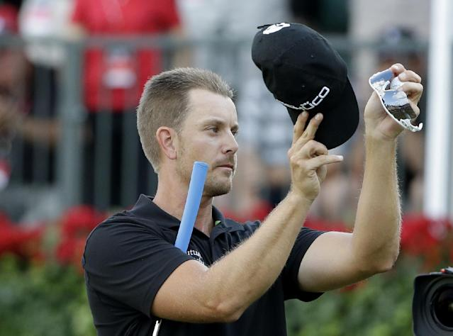 Henrik Stenson, of Sweden, celebrates after winning the Tour Championship golf tournament and FedEx Cup at East Lake Golf Club, in Atlanta, Sunday, Sept. 22, 2013. (AP Photo/David Goldman)