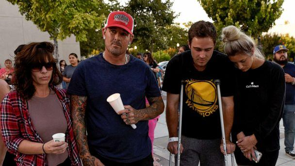 PHOTO: Survivors of the shooting at the Gilroy Garlic Festival, Shannon Gilbert, Brendon Gorshe, Nick McFarland and Sarah Ordaz, attend a vigil outside of Gilroy City Hall, in Gilroy, Calif., July 29, 2019. (Kate Munsch/Reuters)