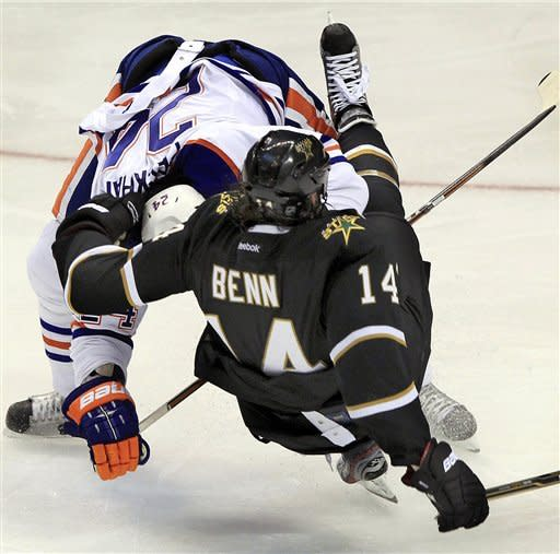 Edmonton Oilers defenseman Theo Peckham (24), of Canada, collides with Dallas Stars left wing Jamie Benn (14), of Canada, during the third period of an NHL hockey game on Saturday, Jan. 7, 2012, in Dallas. Dallas won 4-1. (AP Photo/John F. Rhodes)