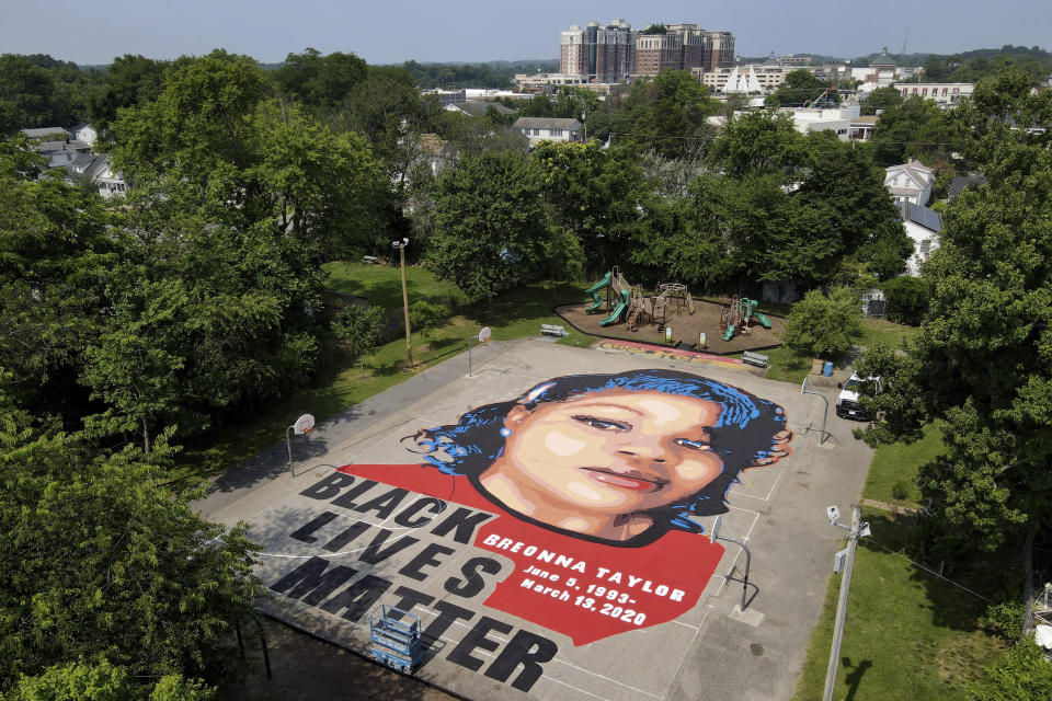 A ground mural depicting a portrait of Breonna Taylor is seen at Chambers Park, Monday, July 6, 2020, in Annapolis, Md. The mural honors Taylor, a 26-year old Black woman who was fatally shot by police in her Louisville, Kentucky, apartment. The artwork was a team effort by the Banneker-Douglass Museum, the Maryland Commission on African American History and Culture, and Future History Now, a youth organization that focuses on mural projects. (AP Photo/Julio Cortez)