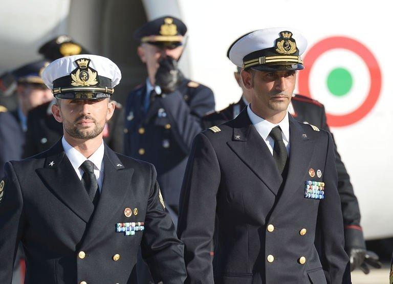 """Italian marines Massimiliano Latorre (right) and Salvatore Girone arrive at Ciampino airport near Rome, on December 22, 2012. Sonia Gandhi -- the Italian-born head of India's ruling party -- has accused Rome of an unacceptable """"betrayal"""" as she waded into a bitter dispute over two marines who have skipped bail"""