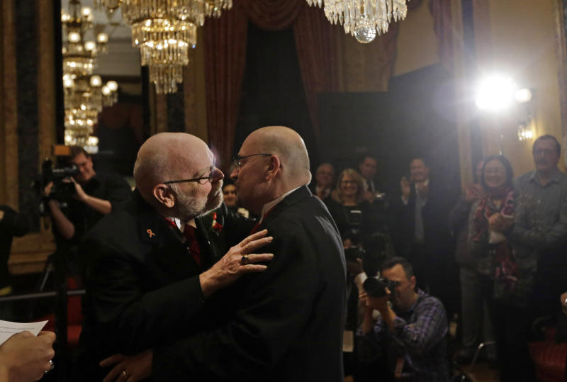 James Scales, left, and William Tasker kiss during a marriage ceremony at City Hall in Baltimore, Tuesday, Jan. 1, 2013. Same-sex couples in Maryland are now legally permitted to marry under a new law that went into effect after midnight on Tuesday. Maryland is the first state south of the Mason-Dixon Line to approve same-sex marriage. (AP Photo/Patrick Semansky)