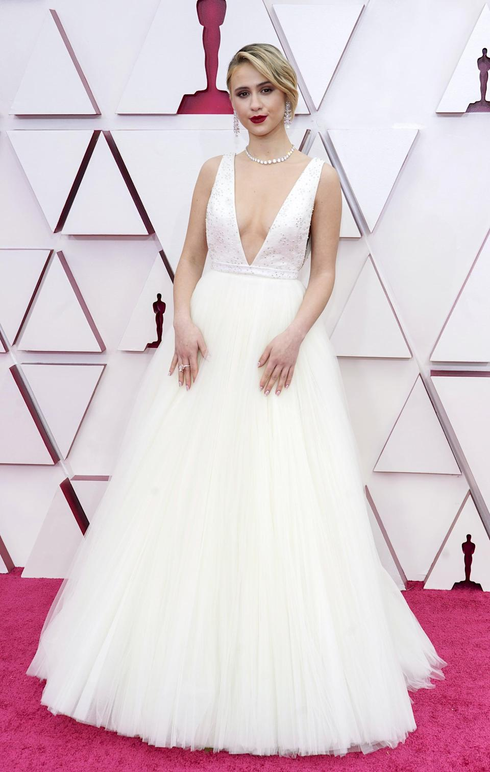 <p>Maria Bakalova wore a bold red lip that contrasted with her all-white ensemble.</p>