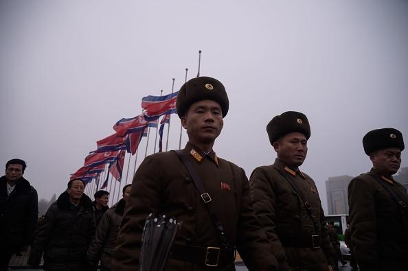 Korean People's Army (KPA) soldiers make their way to pay their respects to late North Korean leader Kim Jong Il, on the anniversary of his death, at Mansu Hill in Pyongyang.
