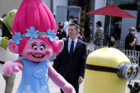 California Governor Gavin Newsom arrives to a news conference at Universal Studios in Universal City, Calif., on Tuesday, June 15, 2021. Starting Tuesday, there were no more state rules on social distancing, and no more limits on capacity at restaurants, bars, supermarkets, gyms, stadiums or anywhere else. (AP Photo/Ringo H.W. Chiu)