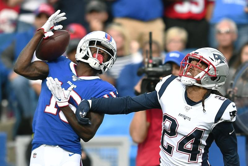 Buffalo Bills wide receiver John Brown catches a pass in front of New England Patriots cornerback Stephon Gilmore (24) in the second half of an NFL football game, Sunday, Sept. 29, 2019, in Orchard Park, N.Y. (AP Photo/Adrian Kraus)