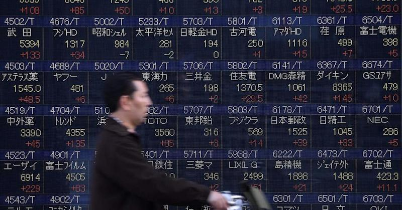 Most Asian shares slide as investors digest China data; ASX falls 0.9%