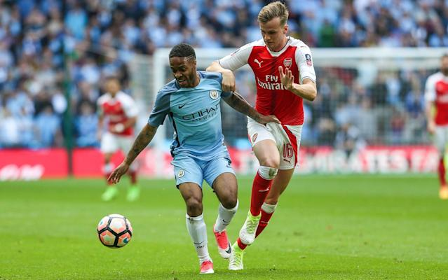 <span>Rob Holding (right), the Arsenal defender, tracks Raheem Sterling</span> <span>Credit:  Rex Features </span>