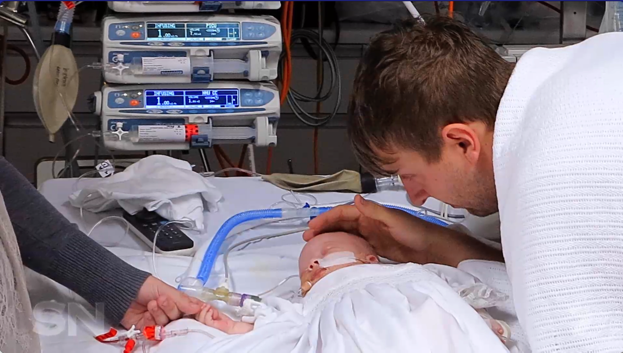 Riley was baptised in hospital when, after just days, doctors said he wouldn't survive