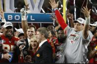 FILE - Kansas City Chiefs owners chairman Clark Hunter, foreground center, and his mother, Norma Hunt, celebrate with quarterback Patrick Mahomes, right, and others after the NFL Super Bowl 54 football game against the San Francisco 49ers in Miami Gardens, Fla., in this Feb. 2, 2020, file photo. The Kansas City Chiefs won 31-20. The matriarch of the Kansas City Chiefs will continue her streak of seeing every Super Bowl in person. Chiefs chairman Clark Hunt says his 82-year-old mother will make the trip to Tampa, Florida, to see Kansas City play the Buccaneers. (AP Photo/Mark Humphrey, File)