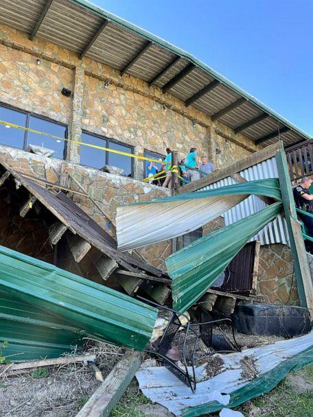 PHOTO: Investigators with Hamilton County, TN Office of Emergency Management & Homeland Security survey the collapse of a deck at Zoi's Restaurant in Harbor Lights Marina in Soddy-Daisy, Tenn., May 1, 2021. (Hamilton County, TN Office of Emergency Management & Homeland Security via Twitter)