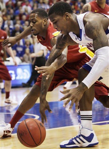 Kansas forward Thomas Robinson (0) and Iowa State forward Melvin Ejim (3) tangle over a loose ball during the first half of an NCAA college basketball game in Lawrence, Kan., Saturday, Jan. 14, 2012. (AP Photo/Orlin Wagner)
