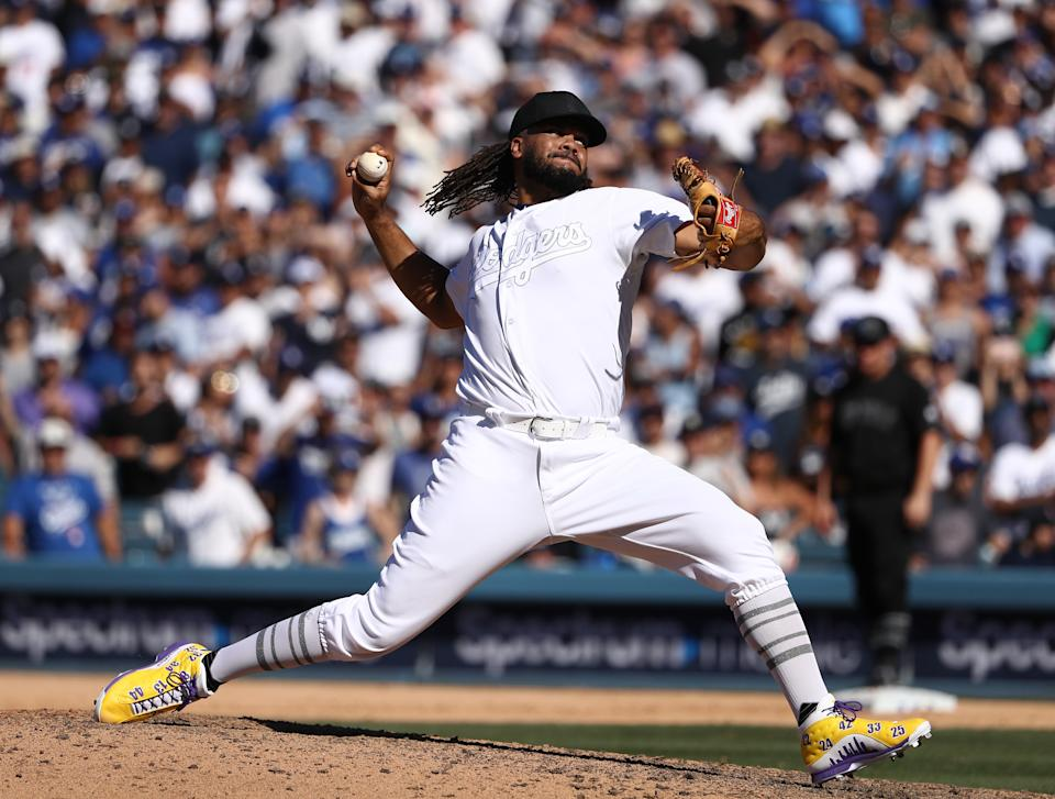 LOS ANGELES, CALIFORNIA - AUGUST 24: Closing pitcher Kenley Jansen #74 of the Los Angeles Dodgers pitches in the ninth inning of the MLB game between the New York Yankees and the Los Angeles Dodgers at Dodger Stadium on August 24, 2019 in Los Angeles, California. Teams are wearing special color-schemed uniforms with players choosing nicknames to display for Players' Weekend. (Photo by Victor Decolongon/Getty Images)