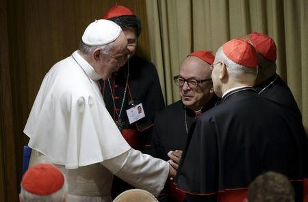Pope Francis talks with cardinals as he leads the synod on the family in the Synod hall at the Vatican, October 5, 2015. REUTERS/Max Rossi