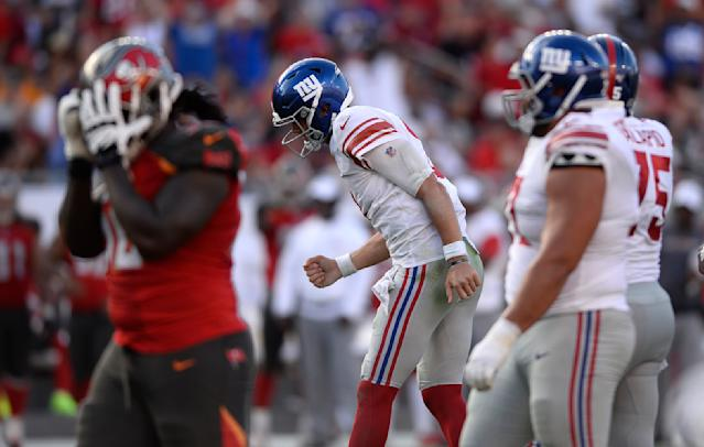 New York Giants quarterback Daniel Jones (8) pumps his fist after a play against the Tampa Bay Buccaneers during the second half of an NFL football game Sunday, Sept. 22, 2019, in Tampa, Fla. (AP Photo/Jason Behnken)