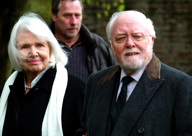 Sir Richard Attenborough and his wife Sheila Sim arrive at St. Mary The Virgin church in Denham, England, on April 27, 2005 (AFP Photo/Max Nash)
