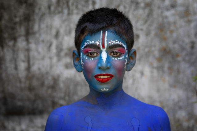 <p>A Hindu boy poses for a picture painted to take part in the celebration of the religious festival Janmashtami, marking the birth anniversary of Lord Sri Krishna. Lord Krishna, the eighth of the ten incarnations of Hindu God Lord Vishnu, who is considered the Preserver of the Universe, is one of Hinduism's most popular gods. (Photo by K M Asad/LightRocket via Getty Images) </p>