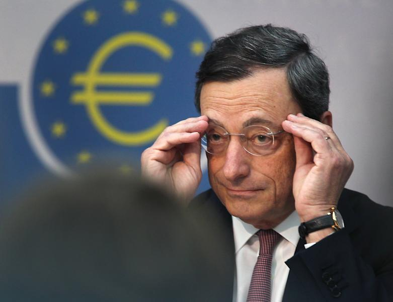President of European Central Bank Mario Draghi adjusts his glasses during a press conference in Frankfurt, Germany, Thursday, July 5, 2012. The European Central Bank has cut its key interest rate by a quarter percentage point to a record low of 0.75 percent to boost a eurozone economy weighed down by the continent's crisis over too much government debt. The move followed a rate cut by China's central bank and new stimulus measures by the Bank of England as global financial authorities seek to shore up a slowing global economy. European leaders last week agreed on new steps to strengthen market confidence in their shared euro currency bloc. They agreed to set up a single banking supervisor to keep bank bailouts from bankrupting countries and made it easier for troubled countries to get bailout help. Those steps helped calm financial markets, which have expected the ECB to follow up with more help in the form of a rate cut. (AP Photo/Michael Probst)