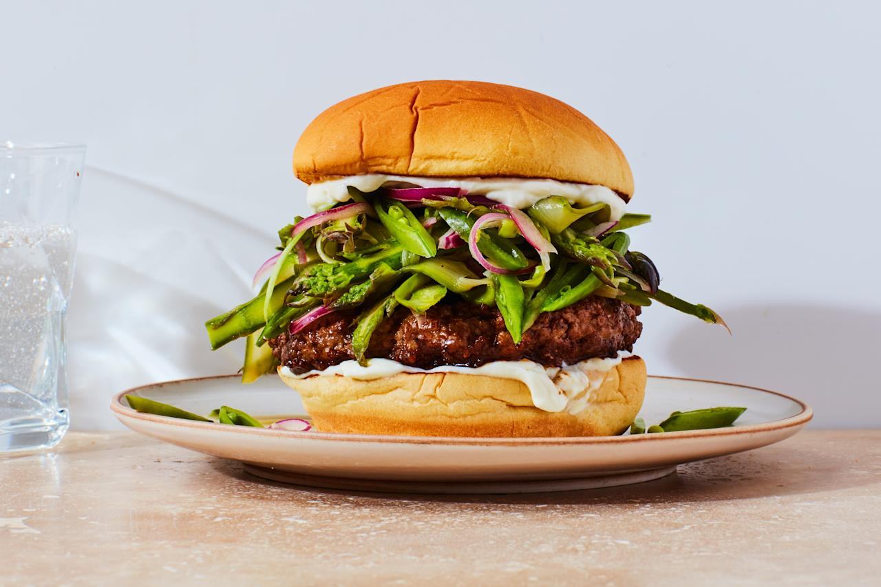 """Pile lemony asparagus, sugar snap peas, and red onion on top of paprika-spiced lamb patties for a springtime burger like no other. <a href=""""https://www.epicurious.com/recipes/food/views/spiced-lamb-burgers-with-asparagus-snap-pea-slaw?mbid=synd_yahoo_rss"""">See recipe.</a>"""