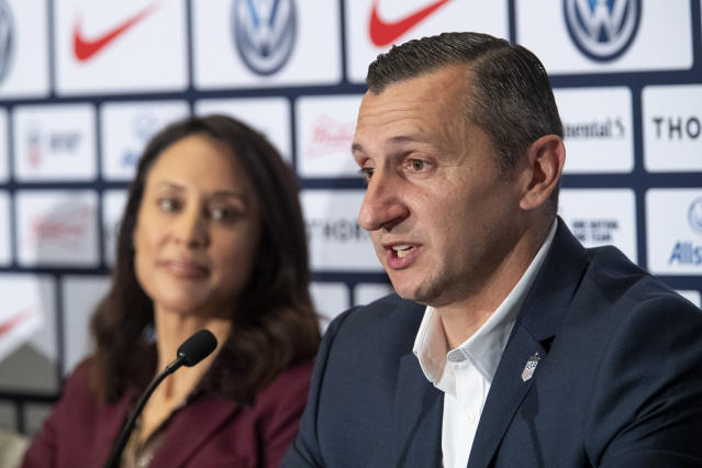 General Manager of the United States women's national soccer team Kate Markgraf, left, listens as Vlatko Andonovski speaks during a news conference, Monday, Oct. 28, 2019, in New York. U.S. Soccer president Carlos Cordeiro named Andonovski as head coach in U.S. Women's National Team on Monday. (AP Photo/Mary Altaffer)