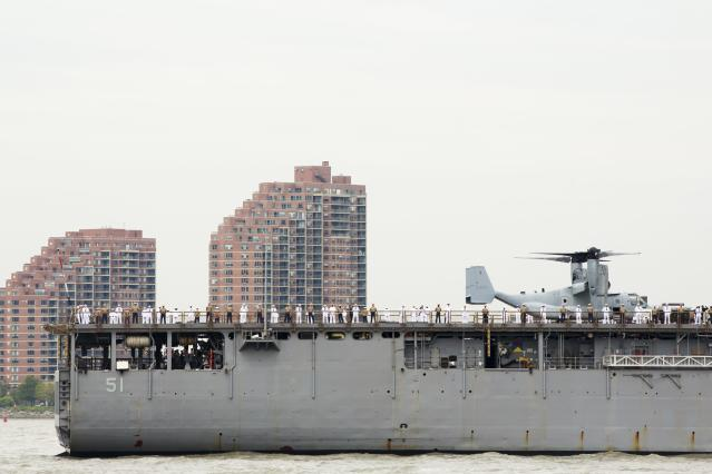 Sailors and an Osprey stand on the deck of the USS Oak Hill, a Harpers Ferry-class dock landing ship of the United States Navy arrives in New York Harbor for Fleet Week in New York, May 21, 2014. REUTERS/Lucas Jackson (UNITED STATES - Tags: SOCIETY MILITARY)