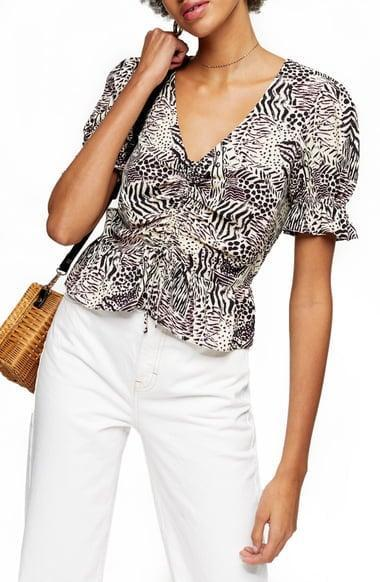 <p><span>Topshop Margot Animal Print Ruched Top</span> ($18, originally $35)</p>