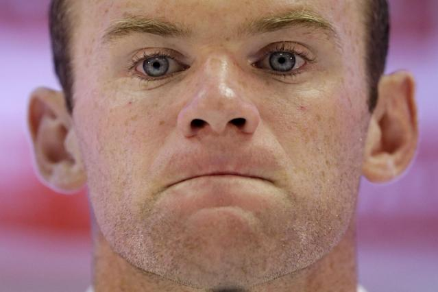 England national soccer team player Wayne Rooney attends a press conference after a squad training session for the 2014 soccer World Cup at the Urca military base in Rio de Janeiro, Brazil, Saturday, June 21, 2014. Costa Rica's surprise 1-0 win over Italy on Friday meant that England made its most humiliating exit from a World Cup since 1958, following consecutive defeats by the Italians and then Uruguay in Group D. England play Costa Rica in their final Group D match on Tuesday. (AP Photo/Matt Dunham)