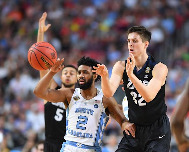 <p>Gonzaga Bulldogs forward Zach Collins (32) passes the ball away from North Carolina Tar Heels guard Joel Berry II (2) in the first half in the championship game of the 2017 NCAA Men's Final Four at University of Phoenix Stadium. Mandatory Credit: Bob Donnan-USA TODAY Sports </p>