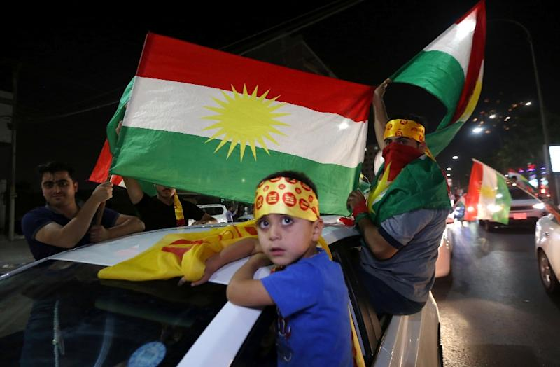 Iraqi Kurds celebrate the results of the independence referendum in the northern city of Arbil, on September 27, 2017
