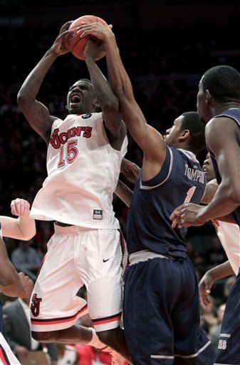 Georgetown's Hollis Thompson, right, gets a hand on the ball while St. John's Sir'Dominic Pointer drives to the basket during the second half of an NCAA college basketball game in New York, Sunday, Jan. 15, 2012. Georgetown beat St. John's 69-49. (AP Photo/Seth Wenig)