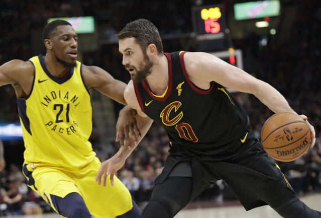 Cleveland Cavaliers' Kevin Love (0) drives past Indiana Pacers' Thaddeus Young (21) in the first half of Game 5 of an NBA basketball first-round playoff series, Wednesday, April 25, 2018, in Cleveland. The Cavaliers won 98-95. (AP Photo/Tony Dejak)