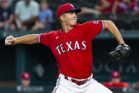 Texas Rangers starting pitcher Glenn Otto throws during the first inning of a baseball game against the Houston Astros, Friday, Aug. 27, 2021, in Arlington, Texas. (AP Photo/Sam Hodde)