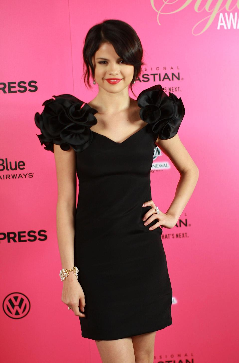 <p>Selena turned heads in a black dress at the Hollywood Style Awards in LA.</p>