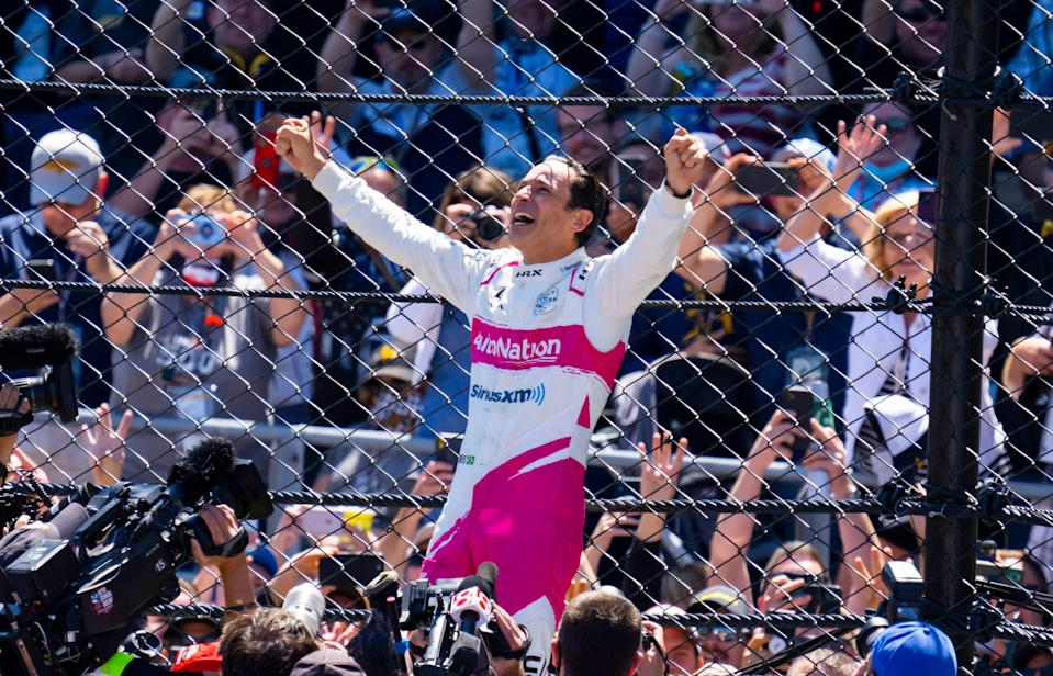 Helio Castroneves celebrates after winning the 105th Indy 500 at Indianapolis Motor Speedway.