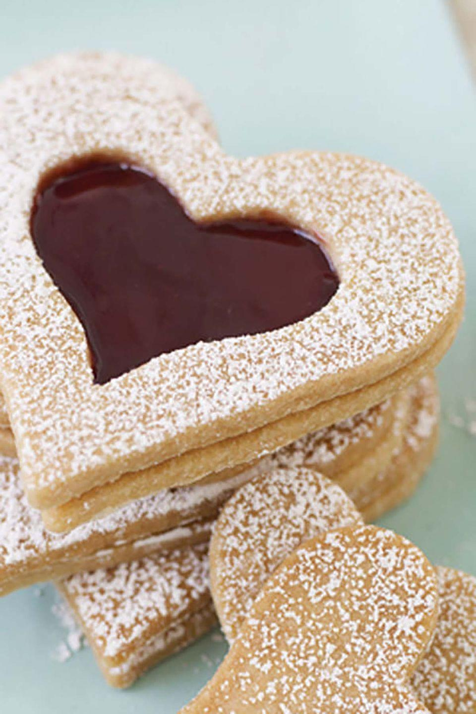 """<p>Show your love for mom with these jam-filled, buttery-vanilla hearts, coated with a sprinkle of confectioners' sugar for added sweetness.</p><p><strong><a href=""""https://www.countryliving.com/food-drinks/recipes/a6582/vanilla-shortbread-hearts/"""" rel=""""nofollow noopener"""" target=""""_blank"""" data-ylk=""""slk:Get the recipe"""" class=""""link rapid-noclick-resp"""">Get the recipe</a>.</strong></p>"""