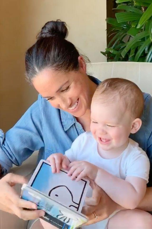 "<p>Meghan wore a casual chambray shirt paired with a messy bun to read to Archie in a new video to mark his first birthday. <a href=""https://www.townandcountrymag.com/society/tradition/a32320817/archie-meghan-markle-prince-harry-first-birthday-reading-video/"" target=""_blank"">Get all the details here. </a></p>"