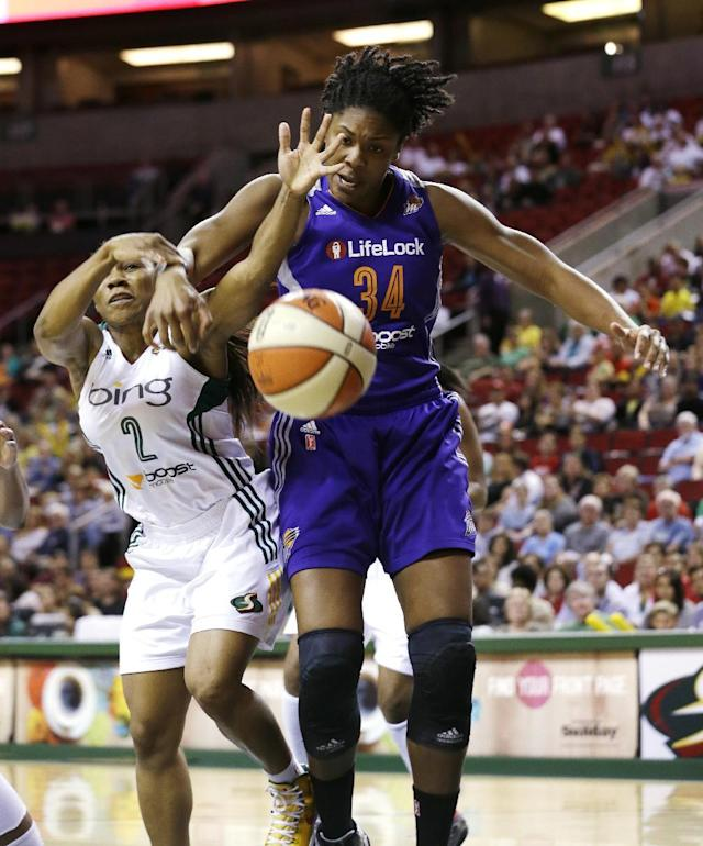 Seattle Storm's Temeka Johnson (2) and Phoenix Mercury's Krystal Thomas fight for a loose ball in the first half of a WNBA basketball game on Thursday, Aug. 1, 2013, in Seattle. (AP Photo/Elaine Thompson)
