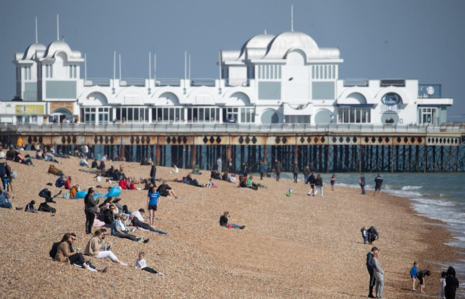 People enjoy the warm weather on Southsea beach in Hampshire. Picture date: Sunday April 4, 2021.