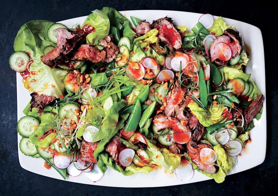 """The steak can be marinated a day in advance—in fact, it gets better. <a href=""""https://www.bonappetit.com/recipe/steakhouse-salad-with-red-chile-dressing-and-peanuts?mbid=synd_yahoo_rss"""" rel=""""nofollow noopener"""" target=""""_blank"""" data-ylk=""""slk:See recipe."""" class=""""link rapid-noclick-resp"""">See recipe.</a>"""