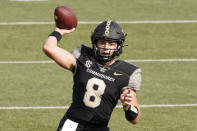 Vanderbilt quarterback Ken Seals (8) passes against the Florida in the first half of an NCAA college football game Saturday, Nov. 21, 2020, in Nashville, Tenn. (AP Photo/Mark Humphrey)