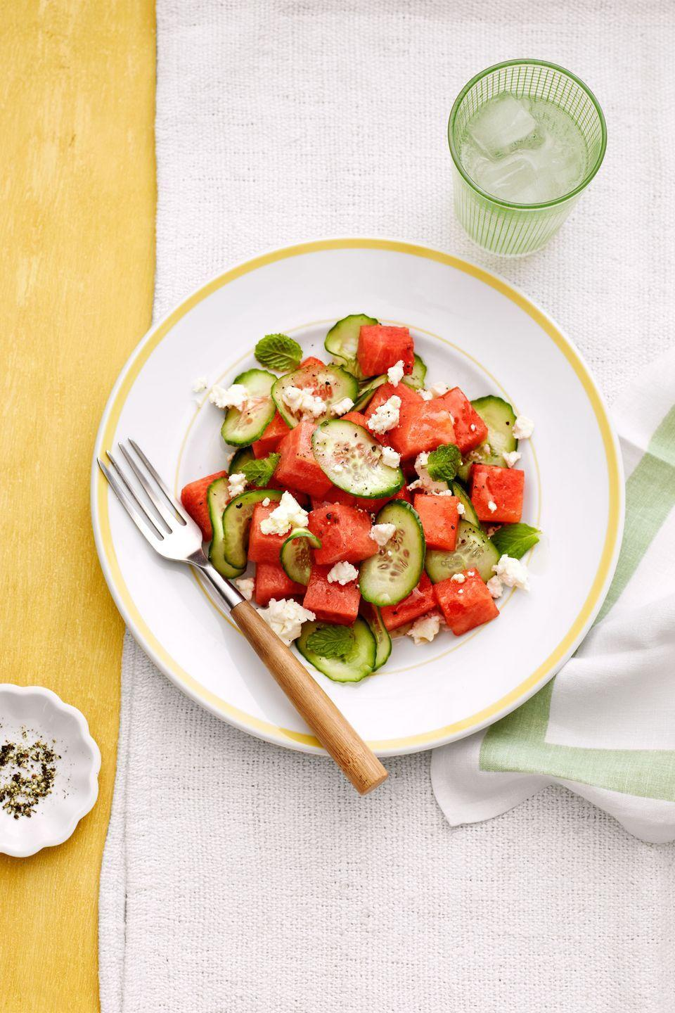 "Light, juicy, and amazingly refreshing, this cool salad is just the thing to serve outside on a scorching summer day. <a href=""https://www.countryliving.com/food-drinks/recipes/a5423/watermelon-cucumber-salad-recipe-clx0714/"" rel=""nofollow noopener"" target=""_blank"" data-ylk=""slk:Get the recipe."" class=""link rapid-noclick-resp""><strong>Get the recipe.</strong></a>"