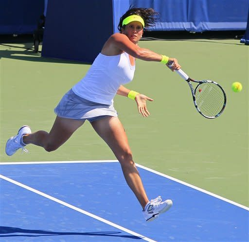 Sofia Arvidsson, from Sweden, hits a forehand against Agnieszka Radwanska, from Poland, during a match at the Western & Southern Open tennis tournament, Wednesday, Aug. 15, 2012, in Mason, Ohio. (AP Photo/Al Behrman)