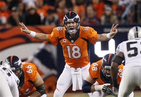 Denver Broncos quarterback Peyton Manning calls the play against the Oakland Raiders in the first quarter of their NFL football game in Denver September 23, 2013. REUTERS/Rick Wilking