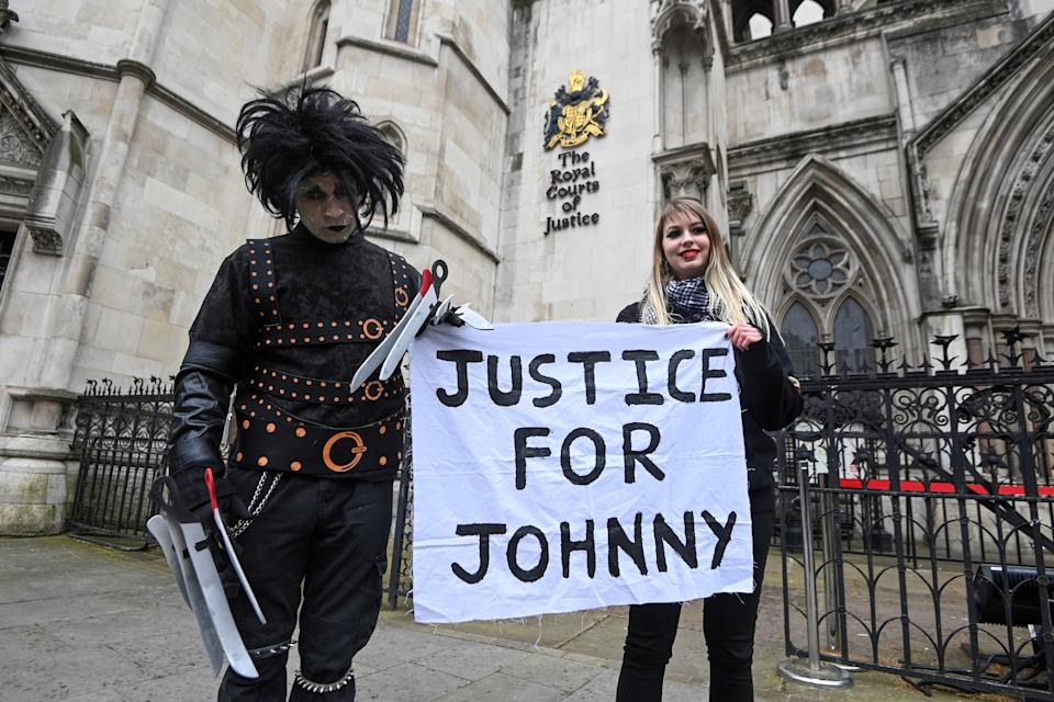 Supporters of actor Johnny Depp pose outside the High Court in London, Britain, March 18, 2021. REUTERS/Toby Melville     TPX IMAGES OF THE DAY. REFILE - CORRECTING YEAR
