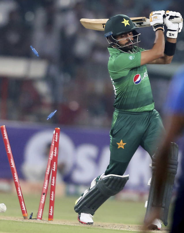 Pakistan's Babar Azam is dismissed by Sri Lankan bowler during the second Twenty20 match between Pakistan and Sri Lanka in Lahore, Pakistan, Monday, Oct. 7, 2019. Sri Lanka won the toss and elected to bat in the second Twenty20 against Pakistan. (AP Photo/K.M. Chaudary)
